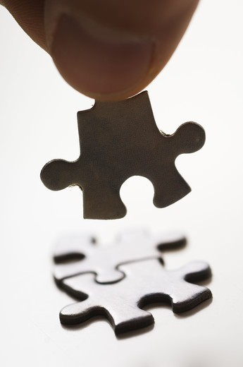Stock Photo: 4400R-3534 Human hand holding jigsaw piece, close-up