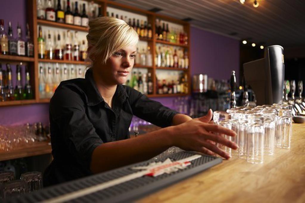 Stock Photo: 4400R-3599 Young Scandinavian female bartender, Sweden.