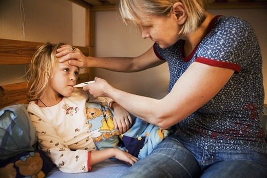 Stock Photo: 4400R-3873 Mother taking care of sick daughter, Sweden.
