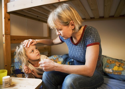 Stock Photo: 4400R-3874 Mother taking care of sick daughter, Sweden.