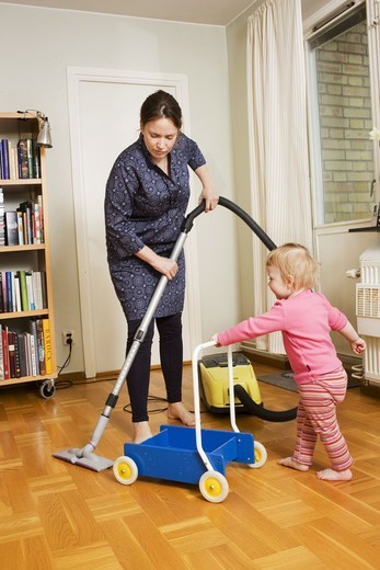 A woman vacuuming, Sweden. : Stock Photo