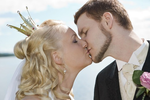 Stock Photo: 4400R-4290 Bride and groom kiss on wedding day