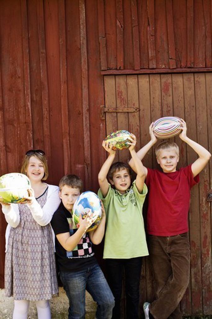 Stock Photo: 4400R-4438 Children holding big Easter eggs