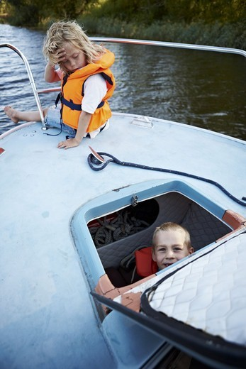 Stock Photo: 4400R-4564 Children sitting in boat