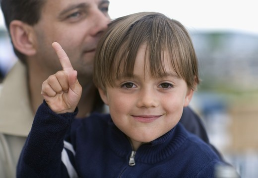 Boy with father, smiling : Stock Photo