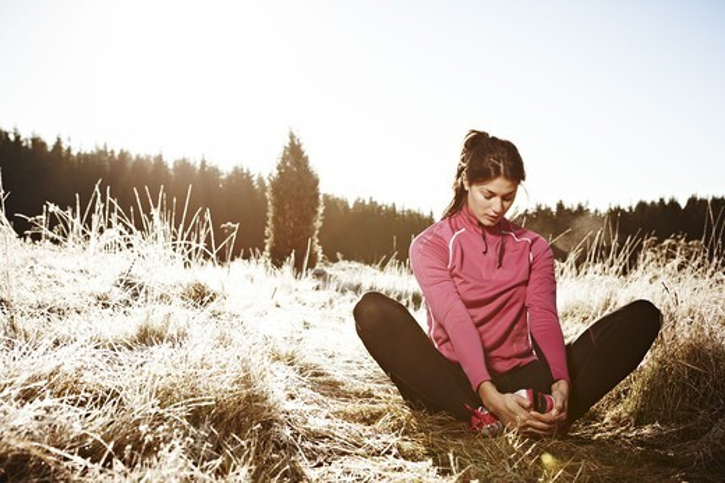 Woman sitting on grass : Stock Photo