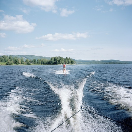 Stock Photo: 4400R-5194 Person waterskiing on lake