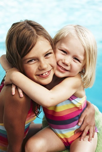 Stock Photo: 4400R-5224 Portrait of two girls hugging