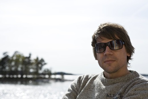 Stock Photo: 4400R-5430 A man wearing sunglasses, Sweden.