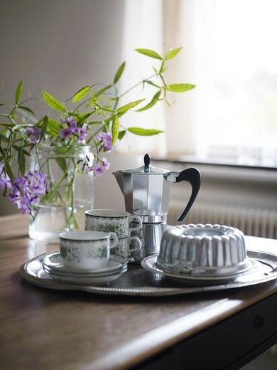 A tray with coffee cups and a sponge cake, Sweden. : Stock Photo