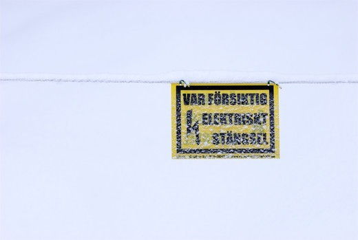 Stock Photo: 4401R-10503 A warning sign covered in snow, Sweden.