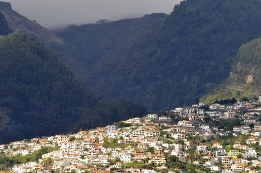 Stock Photo: 4401R-11028 Town at a mountain