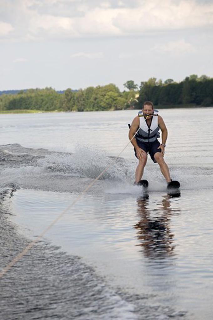 Stock Photo: 4401R-13351 Man waterskiing