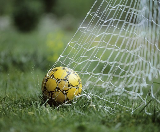 Stock Photo: 4401R-13513 Soccer ball in goal net