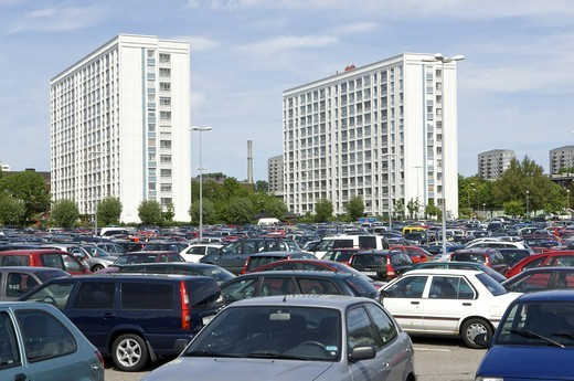 Stock Photo: 4401R-13742 Cars on parking lot wit high rise apartment buildings in background