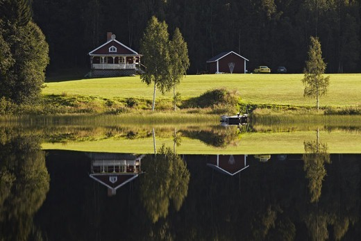 Stock Photo: 4401R-13918 House and trees reflecting in lake