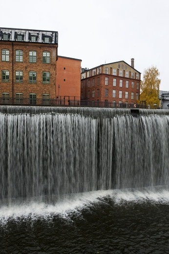Small town with dam : Stock Photo
