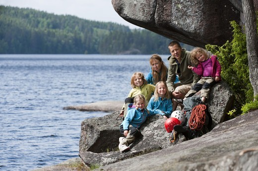 Stock Photo: 4401R-14406 Family with four children sitting near the rock with their climbing equipment