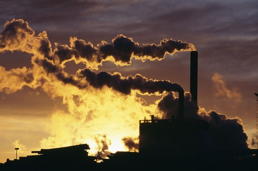 Stock Photo: 4401R-3115 Smoke coming out of chimneys