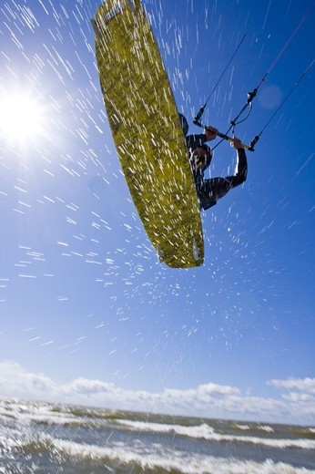 Stock Photo: 4401R-3898 A kitesurfer in action, Sweden.