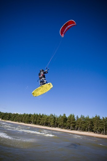 Stock Photo: 4401R-3910 A kitesurfer in action, Sweden.