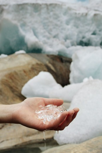 Stock Photo: 4401R-4136 A hand holding melting ice, Norway.