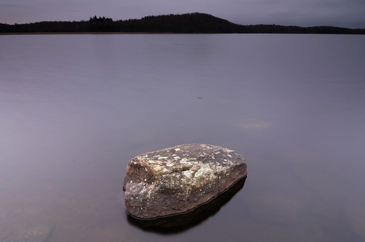 A rock in a lake, Sweden. : Stock Photo