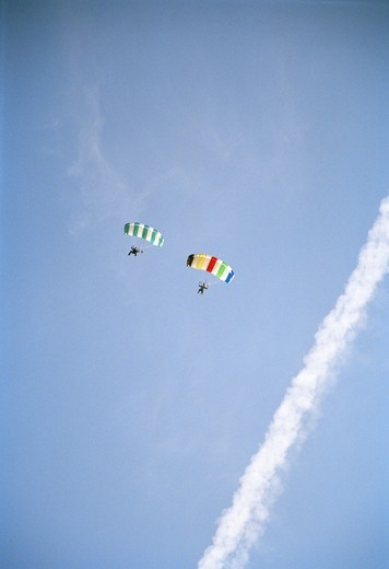 Two parachute jumpers, Sweden. : Stock Photo
