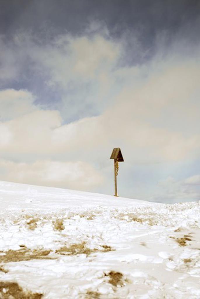 Stock Photo: 4401R-6558 A Jesus cross in the snow, Trentino, Italy.