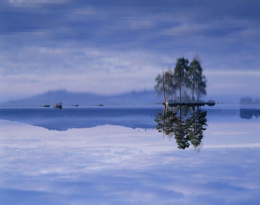 Stock Photo: 4401R-8651 Islands in a peaceful lake, Sweden.