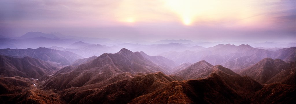 Stock Photo: 4402-2118 Sunset in mountians through which the Great Wall of China runs, near Beijing, China