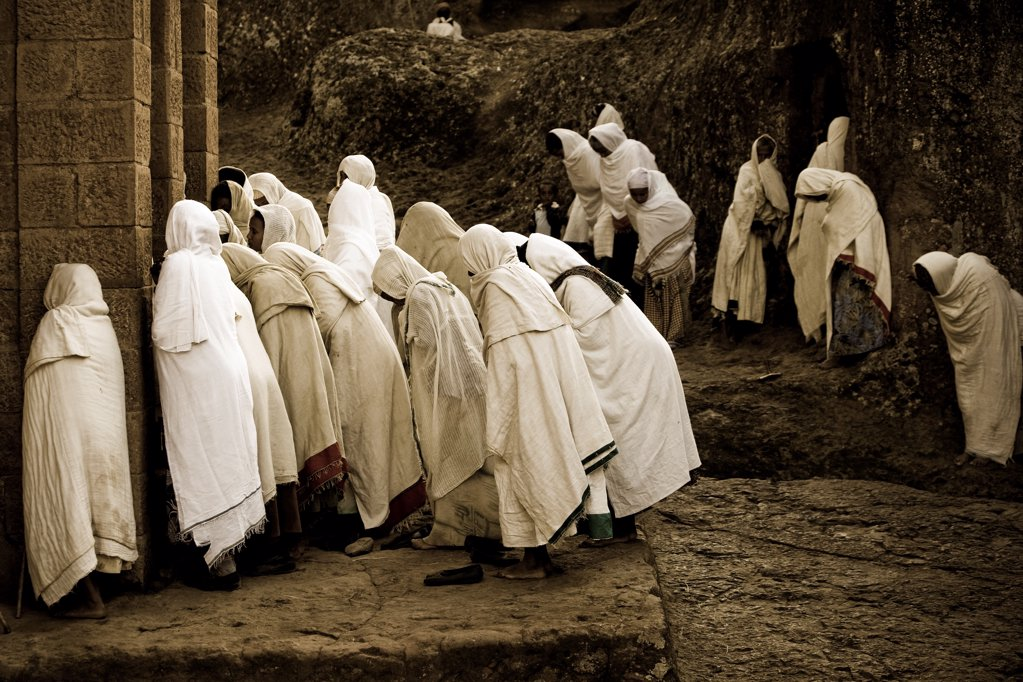 Stock Photo: 4402-3273 Pilgrims praying near the sunken churches of Lalibela, Ethiopia