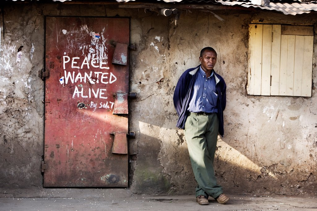 Shop door with slogan 'Peace wanted alive', Nairobi, Kenya. : Stock Photo