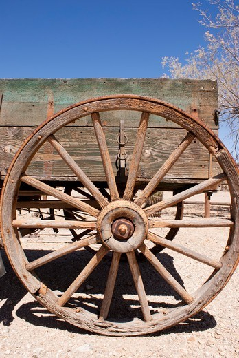 Stock Photo: 4404-1220 USA, Arizona, Tucson, Rusty wagon wheel