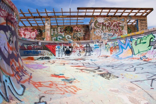 USA, Arizona, Graffiti in abandoned swimming pool at Two Guns ghost town : Stock Photo