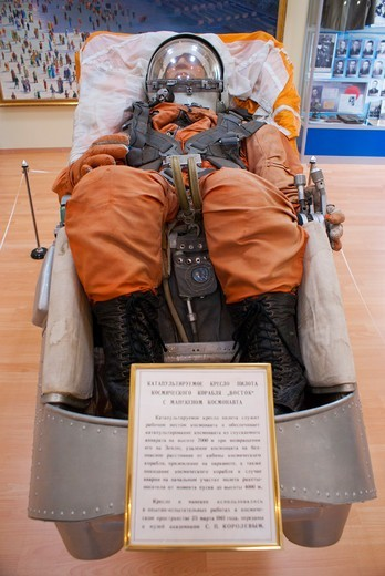 Stock Photo: 4404-1598 Vostok Space Suit (type worn by Yuri Gagarin) posed in ejection seat in a museum, Baikonur Space Museum, Baikonur Cosmodrome, Kazakhstan