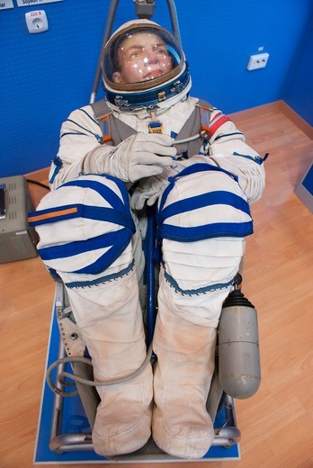 Stock Photo: 4404-1612 Russian Soyuz spacesuit posed in spacecraft seat in a museum, Baikonur Space Museum, Baikonur Cosmodrome, Kazakhstan