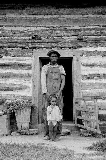 Young sharecropper and his first child, Dorothea Lange : Stock Photo