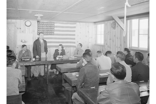 Stock Photo: 4408-2147 Roy Takano [i.e., Takeno] at town hall meeting, Manzanar Relocation Center, California, Ansel Adams