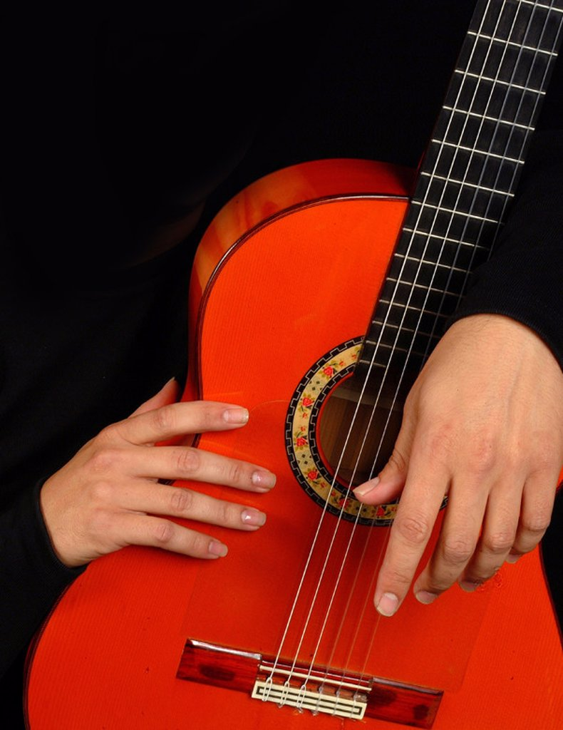 Hands and flamenco guitar photo detail. : Stock Photo