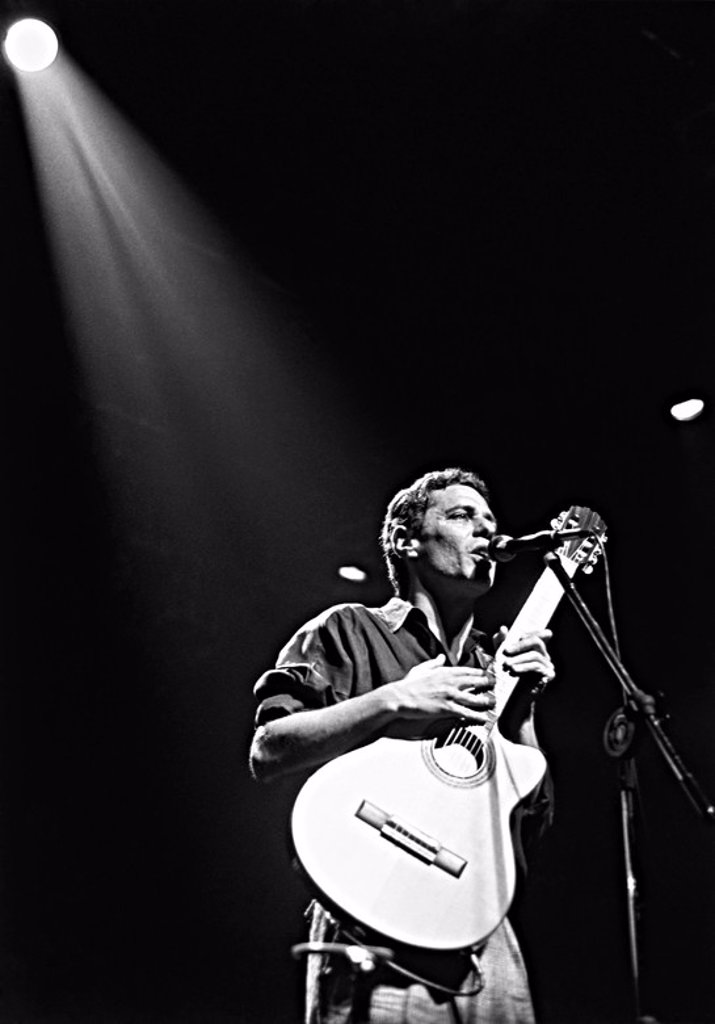 Stock Photo: 4409-27559 Singer-poet Chico Buarque performs in his first show in Sao Paulo, Brazil´s largest city, in 15 years before a full-house of fans who swayed, sang and cried to 25 of his famous love songs. Chico´s melodies have won him international acclaim from Argentina.