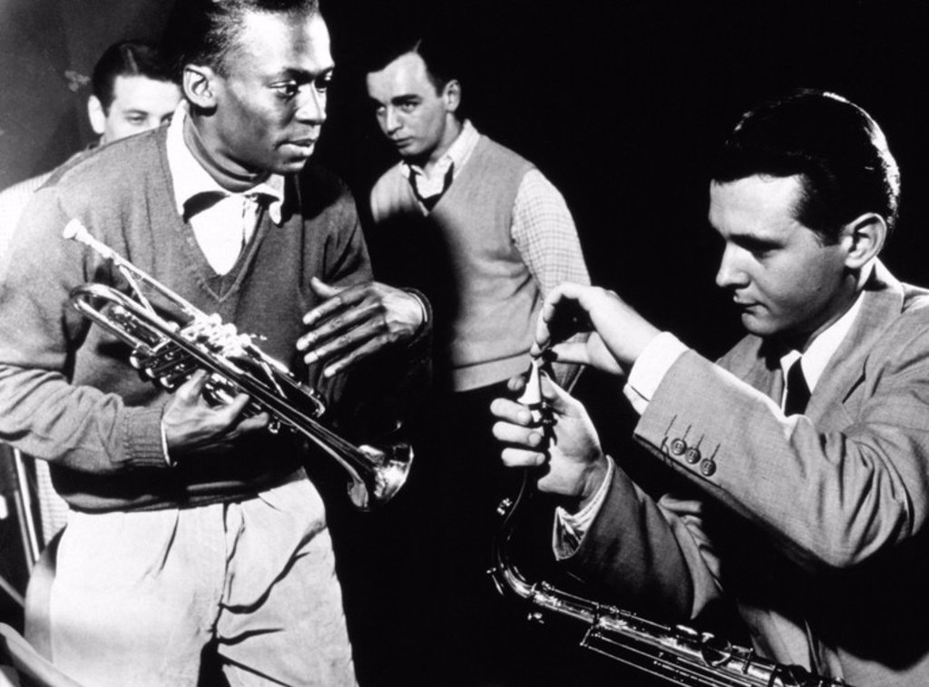 Tenor saxophonist Stan Getz and trumpeter Miles Davis at a recording session in New York City, 1951. : Stock Photo