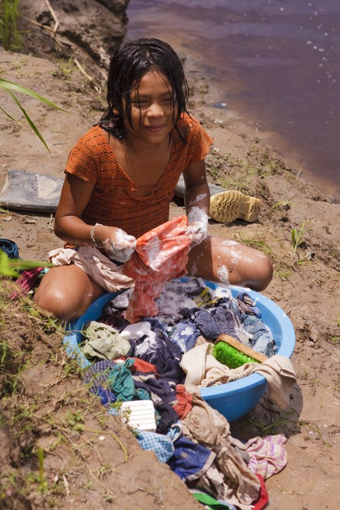 Stock Photo: 4409-31443 Girl washing clothes. Buenos Aires native community. Pacaya Samiria National Reserve. Amazon Basin. Loreto. Peru.