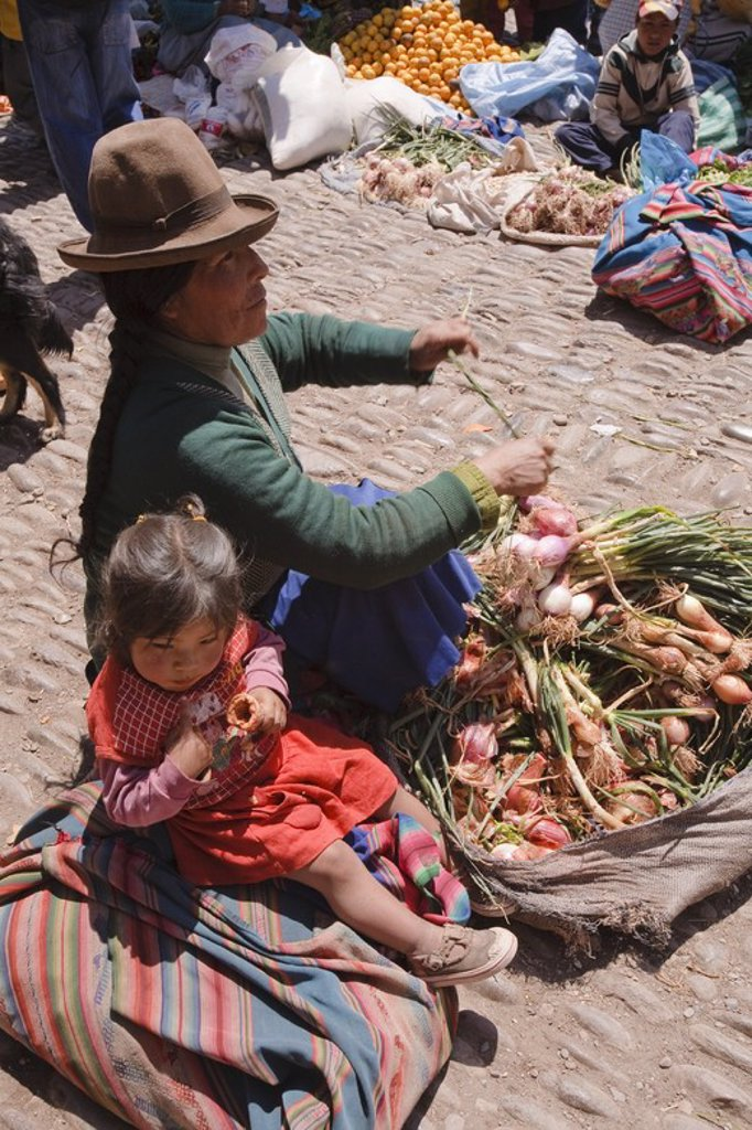 Stock Photo: 4409-32672 Woman Street Vendor in Pisac Market. Sacred Valley. Cusco Departament. Peru.