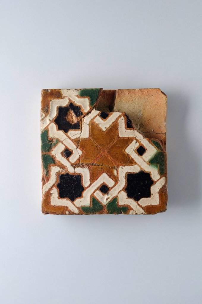 "Stock Photo: 4409-33897 Glazed ceramic tile with geometric decoration 10 x 9, 5 cm. (15 th CE ) - Modern era belonging of the "" Burgo de Santiuste Museum"" in Alcalá de Henares. (Madrid). SPAIN."