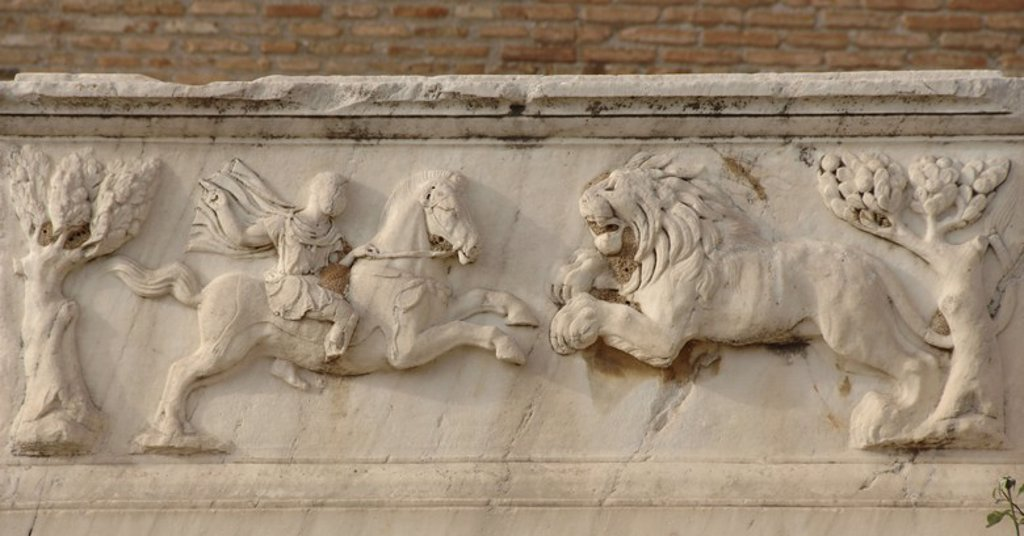 Stock Photo: 4409-34844 Roman Art. Greece. Relief in a Roman tomb around the Odeon. It depicts a Roman soldier on horseback fighting a lion. Patras.