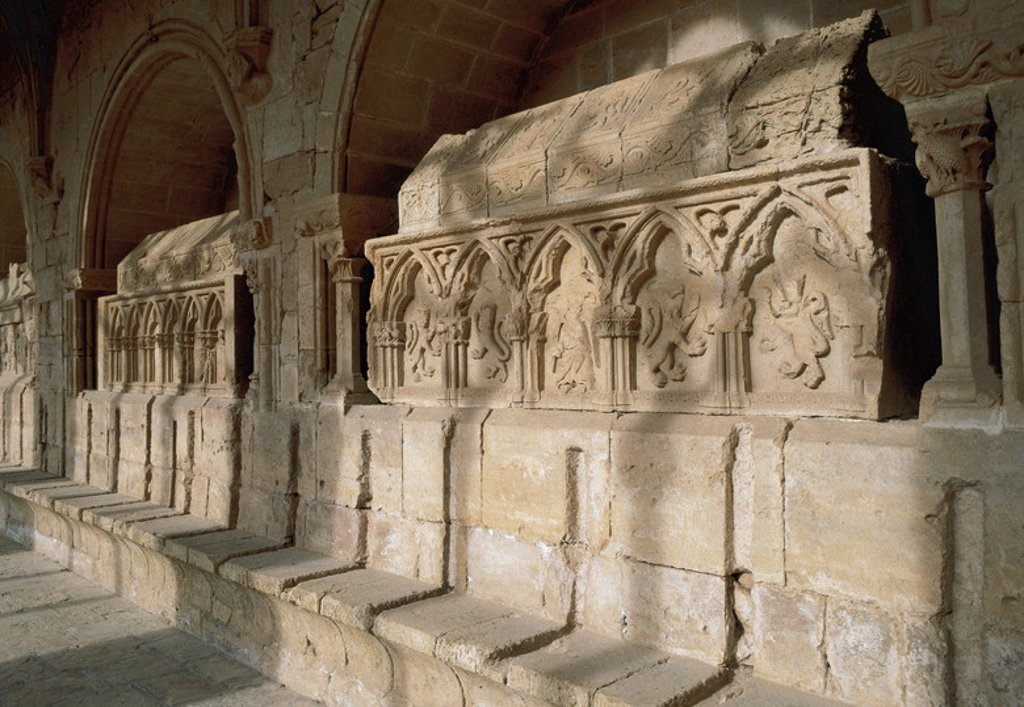 Stock Photo: 4409-34989 Romanesque art. Monastery of Santes Creus. Cistercian Abbey.  Tombs in gothic style of the House of Queralt and House of Puigverd in the cloister. 14th century. Aiguamurcia. Catalonia. Spain.