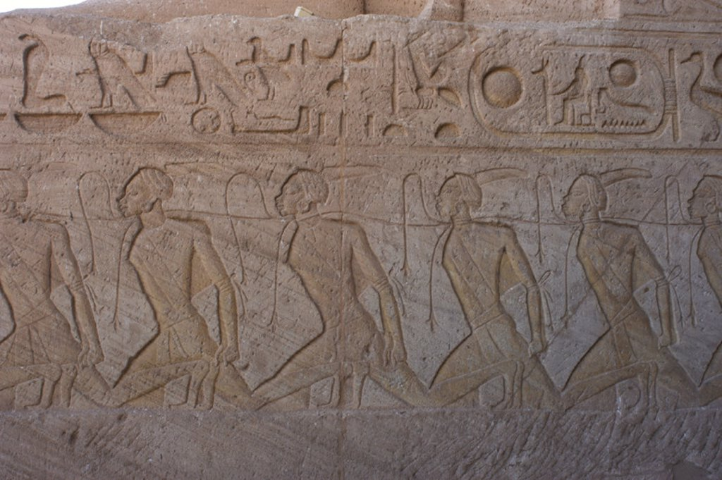 Stock Photo: 4409-35117 Egyptian Art. Relief depicting a group of prisoners with negroid features, Nubians, symbolizing the Egyptian border enemies. Great Temple of Ramses II. 19th dynasty. New Kingdom. Abu Simbel. Egypt.