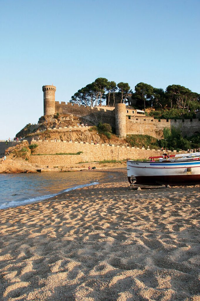 TOSSA DE MAR. Town located in the Costa Brava. Landscape coast. Fishing boat in the sand beach. La Selva Region. Girona Province. Catalonia. Spain. Europe. : Stock Photo