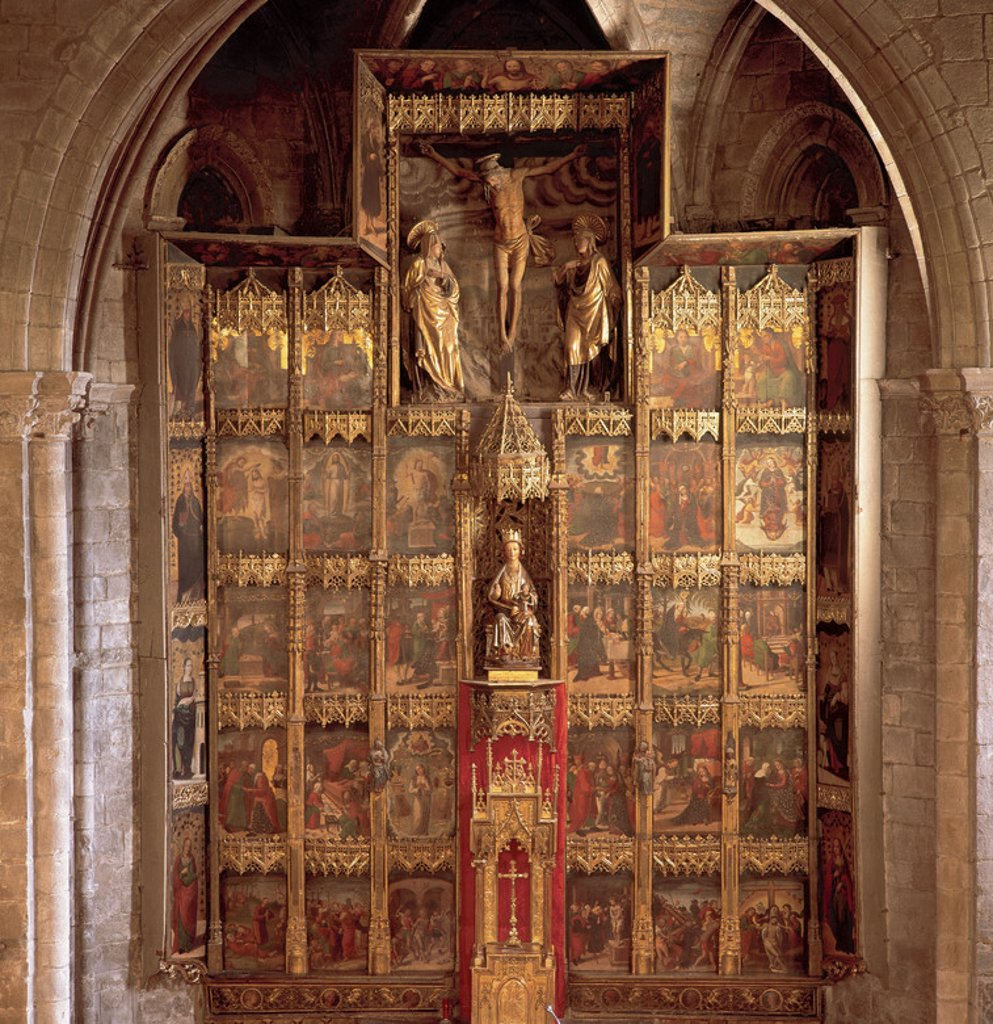 Stock Photo: 4409-36771 RENAISSANCE ART. SPAIN. CHURCH OF SAINT MARY. Altarpiece. Painting transition from Gothic to Renaissance (1515) attributed to the Aragonese Pedro de Aponte. In the center a carving of the Virgin and Child (XIV c.) and above it, a Calvary of the sixteenth century. Olote. Navarre.